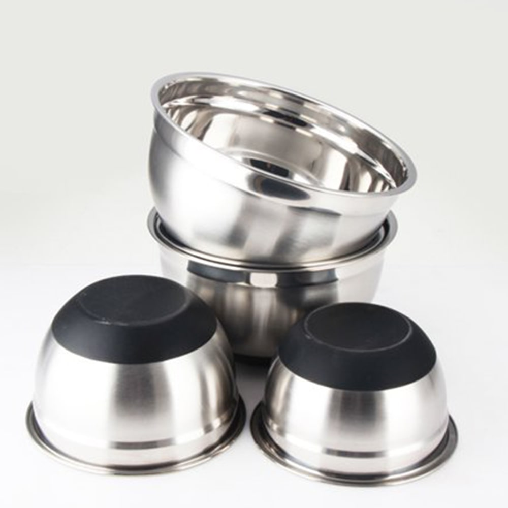 set of stainless steel bowls with a black silicone base